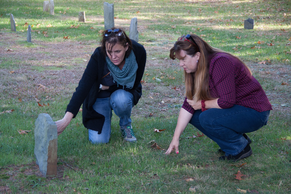 Erin and Kristin examine one of the old headstones in the Eastham cemetery.